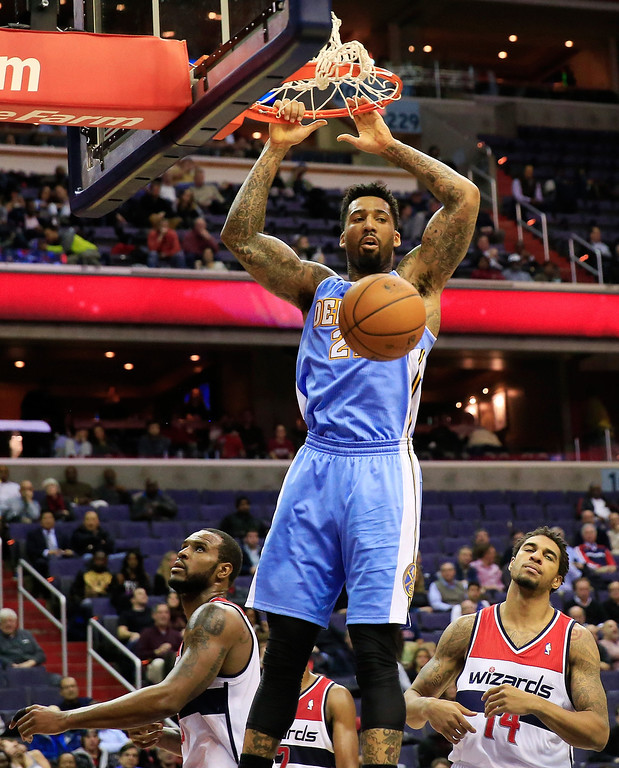. Wilson Chandler #21 of the Denver Nuggets dunks the ball against the Washington Wizards in the fourth quarter during the Nuggets 75-74 win at Verizon Center on December 9, 2013 in Washington, DC.   (Photo by Rob Carr/Getty Images)