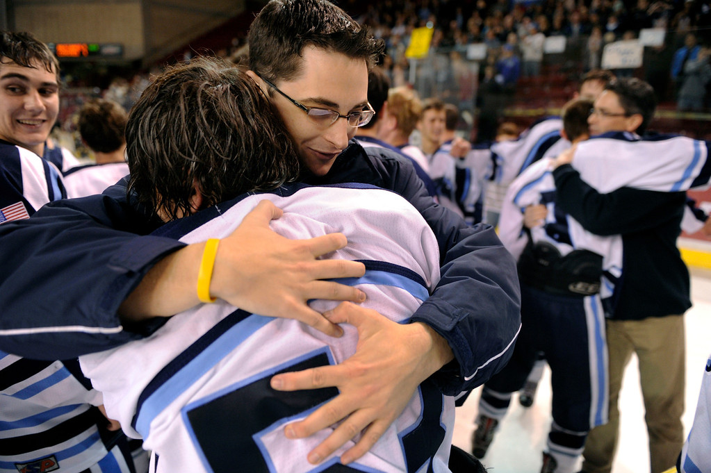 . DENVER, CO. - FEBRUARY 28: Mustangs coach Matt Schoepflin embraced forward Darius Maes after the win Friday night. Ralston Valley High School beat Monarch 5-1 Friday night, March 1, 2013 to win the Colorado hockey championship at Magness Arena in Denver. (Photo By Karl Gehring/The Denver Post)