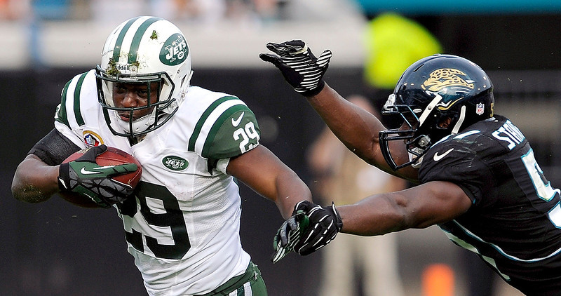 . New York Jets running back Bilal Powell (29) runs for yardage while being pursued by Jacksonville Jaguars outside linebacker Julian Stanford (57) during the second half of an NFL football game, Sunday, Dec. 9, 2012, in Jacksonville, Fla. The Jets beat the Jaguars 17-10. (AP Photo/Stephen Morton)