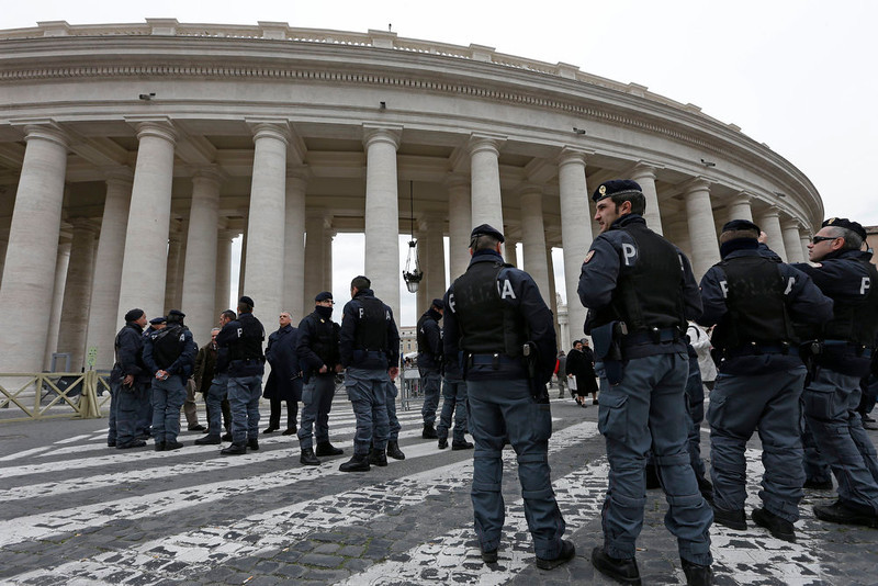 . Italian police stand outside the Bernini Colonnade in St. Peter\'s Square following the Angelus by Pope Francis at the Vatican, Sunday, March 17, 2013. (AP Photo/Alessandra Tarantino)