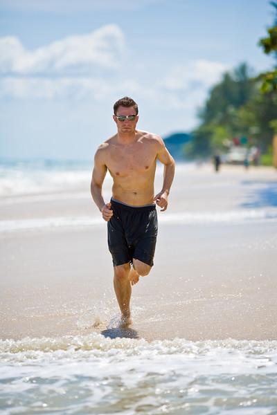 caucasian man running on the beach