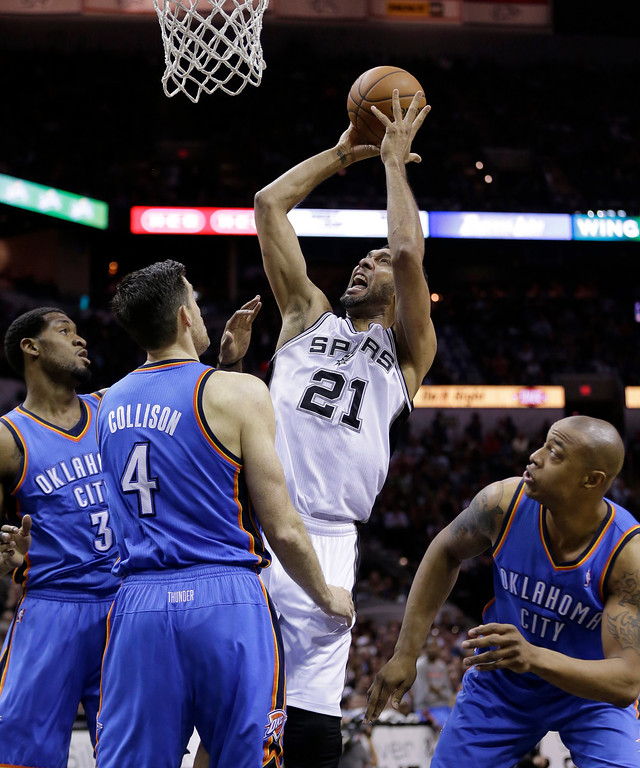 . San Antonio Spurs\' Tim Duncan (21) shoots over Oklahoma City Thunder\'s Perry Jones (3) and Nick Collison (4) during the first half of Game 2 of the Western Conference finals NBA basketball playoff series, Wednesday, May 21, 2014, in San Antonio. (AP Photo/Eric Gay)
