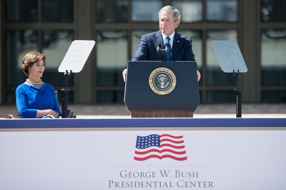 Description of . Former First Lady Laura Bush listens while former US President George W. Bush speaks during a dedication ceremony at the George W. Bush Library and Museum on the grounds of Southern Methodist University April 25, 2013 in Dallas, Texas. The Bush library is dedicated to chronicling the presidency of the United State's 43rd President, George W. Bush. BRENDAN SMIALOWSKI/AFP/Getty Images