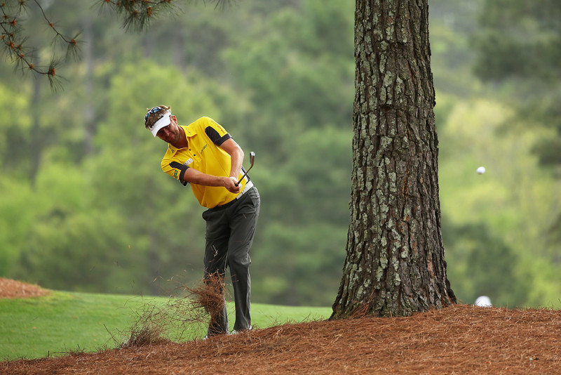 . David Lynn of England hits his second shot on the 15th hole during the first round of the 2013 Masters Tournament at Augusta National Golf Club on April 11, 2013 in Augusta, Georgia.  (Photo by Mike Ehrmann/Getty Images)