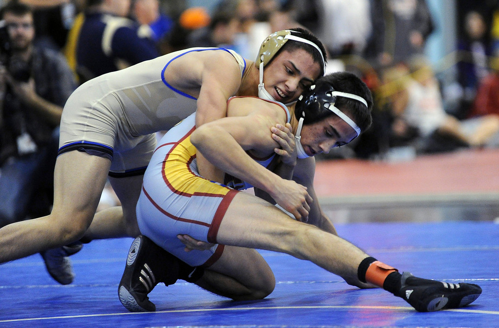 . Drew Romero of Broomfield, left, controls Joel Salomon of Windsor during the 113 pound final of Northern Colorado Christmas Tournament at Island Grove Event Center in Greeley, Colo., on Saturday, Dec. 22, 2012. Romero won the match. Hyoung Chang, The Denver Post