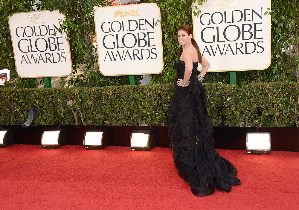 Description of . Actress Debra Messing arrives at the 70th Annual Golden Globe Awards held at The Beverly Hilton Hotel on January 13, 2013 in Beverly Hills, California.  (Photo by Jason Merritt/Getty Images)