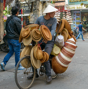 A seller of hats and baskets, Hanoi, Vietnam.