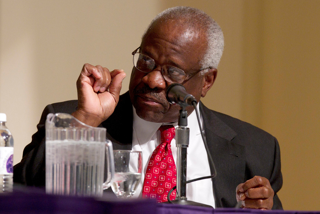 . FILE - In this Jan. 26, 2012 file photo, Supreme Court Justice Clarence Thomas speaks at College of the Holy Cross in Worcester, Mass. Two Supreme Court justices and nine judges on President-elect Donald Trump�s list of potential high court picks are among more than 1,000 people expected at a gathering of conservative lawyers that has suddenly turned into an impromptu job fair for spots in the new administration. The Federalist Society�s national lawyers� convention begins Nov. 17 in Washington as a tribute to the late Justice Antonin Scalia, an early supporter of the group and a hero to many of its 40,000 members.  (AP Photo/Michael Dwyer, File)