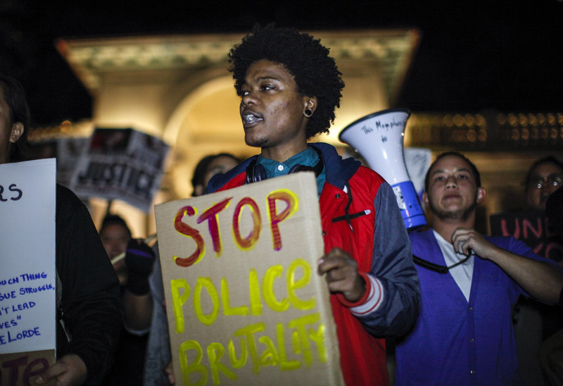 . A demonstrator attends a protest November 24, 2014 in New York in anticipation of the announcement of the Grand Jury decision in the shooting death of an unarmed black teenager. Michael Brown, an 18-year-old male teenager was fatally wounded by Darren Wilson, a white Ferguson Police officer on August 9, 2014 in Ferguson, Missouri.    KENA BETANCUR/AFP/Getty Images