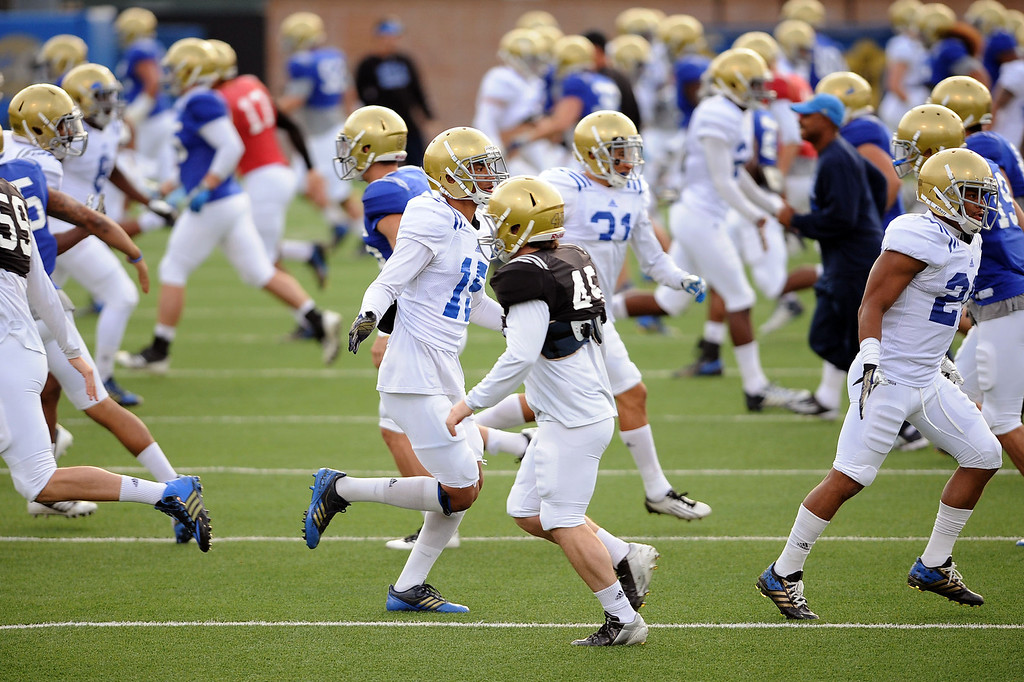 . UCLA football players take the field for one of 14 spring practices April 9, 2014 in Westwood, CA.(Andy Holzman/Los Angeles Daily News)