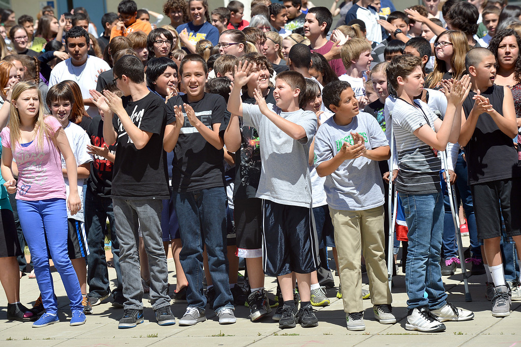 . Students at Martinez Junior high School in Martinez, yell out while creating a video to send well wishes to fellow student Aaron Hern in Martinez, Calif., on Friday, April 19, 2013. Hern is recovering in Boston at Children\'s Hospital after being severely injured at the Boston Marathon explosion last Monday. (Dan Rosenstrauch/Bay Area News Group)