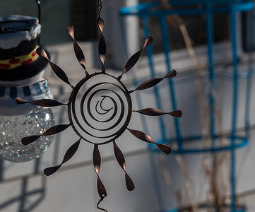 2021 03 12:  Yard Ornaments, Sun, Stained Glass