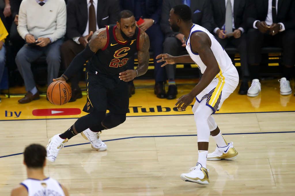 . Cleveland Cavaliers forward LeBron James, left, drives against Golden State Warriors forward Draymond Green during the first half of Game 1 of basketball\'s NBA Finals in Oakland, Calif., Thursday, May 31, 2018. (AP Photo/Ben Margot)