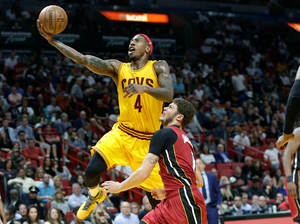 . Cleveland Cavaliers\' Iman Shumpert (4) drives to the basket as Miami Heat\'s Tyler Johnson defends during the first half of an NBA basketball game, Saturday, March 4, 2017, in Miami. (AP Photo/Lynne Sladky)