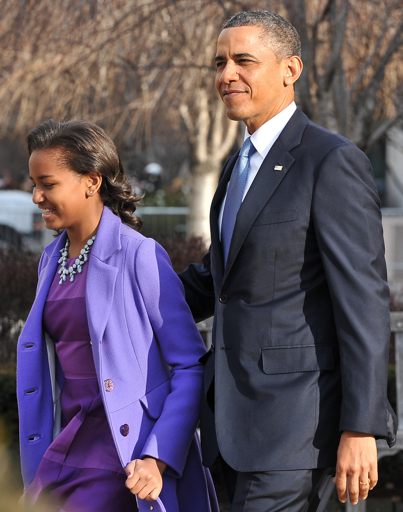 Description of . US President Barack Obama and his daughter Sasha leave St. John's Church on January 21, 2013 in Washington, DC, hours before Obama participates in a ceremonial swearing in for a second term in office.  NICHOLAS KAMM/AFP/Getty Images