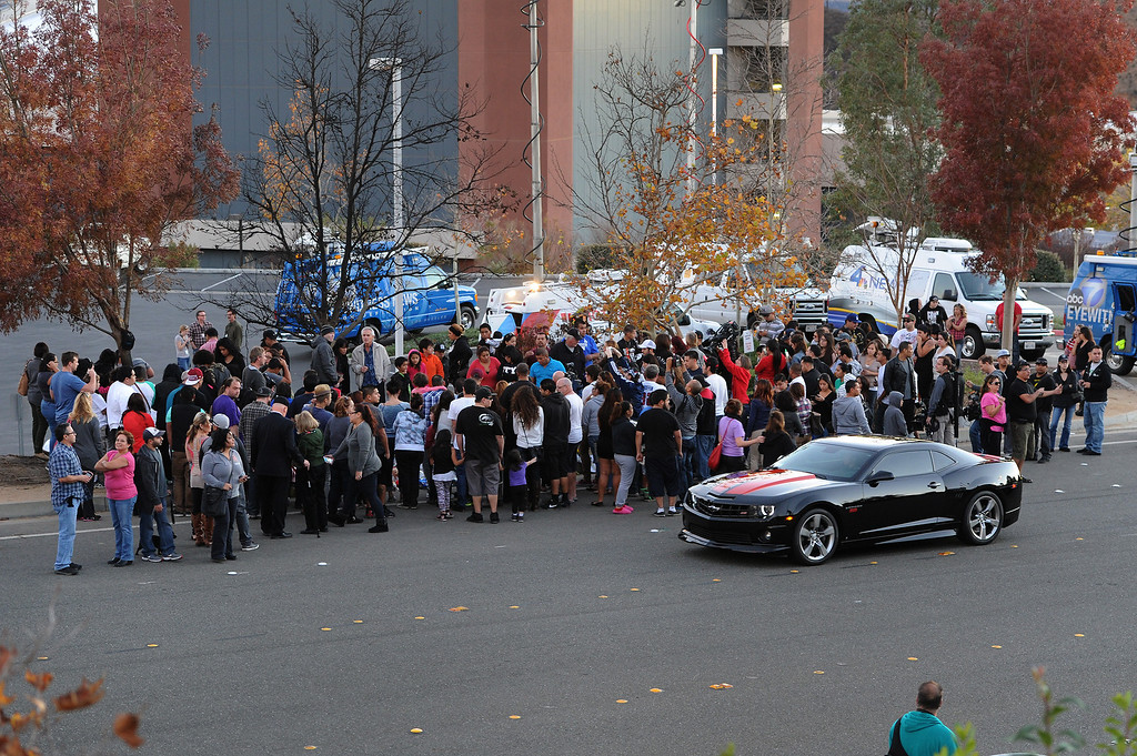 . Crowds gather at a memorial for Paul Walker and Roger Rodas, Sunday, December 1, 2013, at the scene of their fatal crash site on Hercules Street near Kelly Johnson Parkway in Valencia. (Photo by Michael Owen Baker/L.A. Daily News)