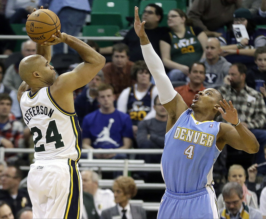 . Utah Jazz\'s Richard Jefferson (24) shoots as Denver Nuggets\' Randy Foye (4) defends in the second quarter during an NBA basketball game, Monday, Jan. 13, 2014, in Salt Lake City. (AP Photo/Rick Bowmer)