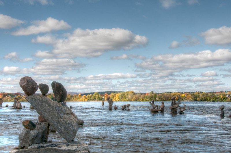 Balanced rock sculptures by John Ceprano in Ottawa River, Ontario, Canada