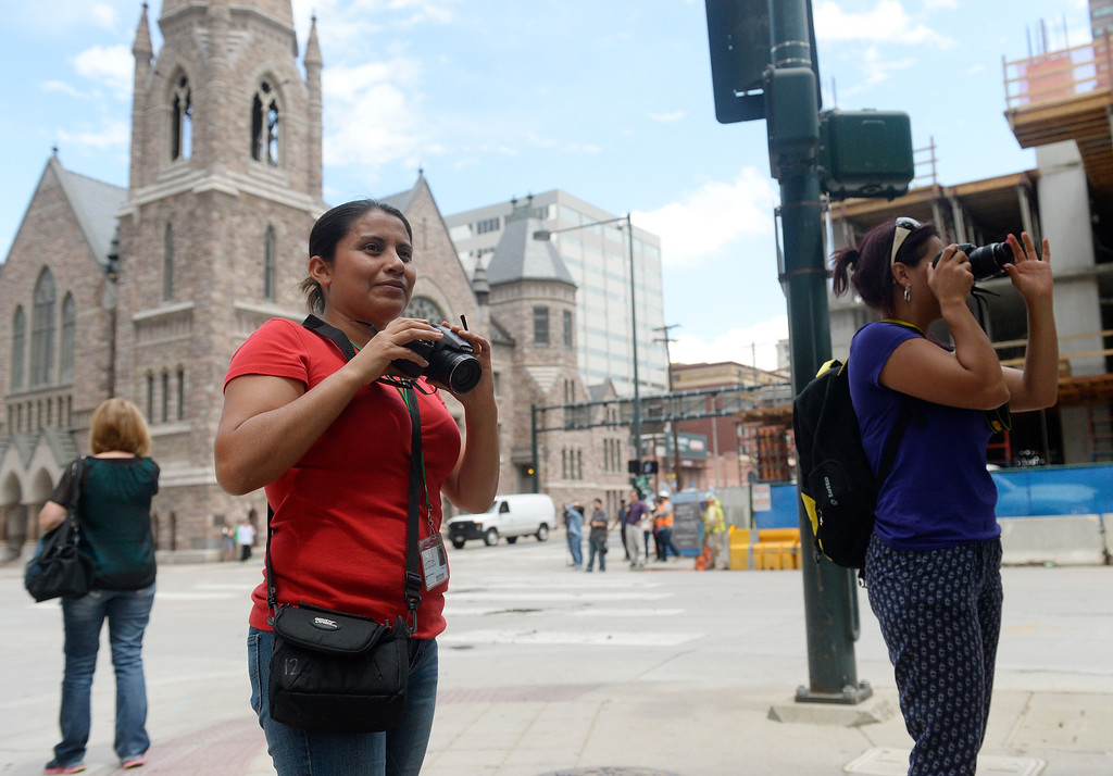 """. Colorado Public TV Channel 12 is sponsoring a photography class  \""""Picture Me Here\"""" as part of the it\'s American Graduate initiative.  Students  Maricela Rivera, left and Sonia Muñoz, right, both originally from Mexico photographed in downtown Denver at Broadway and 18th Ave. The class was held at Emily Griffith Technical School in Denver on Tuesday July 21, 2015.   (Photo by Cyrus McCrimmon/The Denver Post )"""