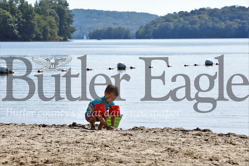 Eagan Smith of Butler enjoys a late summer day at the beach Tuesday with his mom Emily, brother Murphy and some family friends at Lakeview Beach at Moraine State Park. Seb Foltz/Butler Eagle