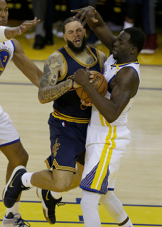 . Golden State Warriors forward Draymond Green, right, defends Cleveland Cavaliers guard Deron Williams during the first half of Game 1 of basketball\'s NBA Finals in Oakland, Calif., Thursday, June 1, 2017. (AP Photo/Ben Margot)