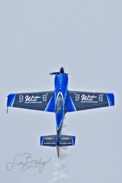 At the top of his climb,  Rob Holland, a world class aerobatic pilot, will experience gravity as it overcomes the engine power, and will stall and spin back to earth