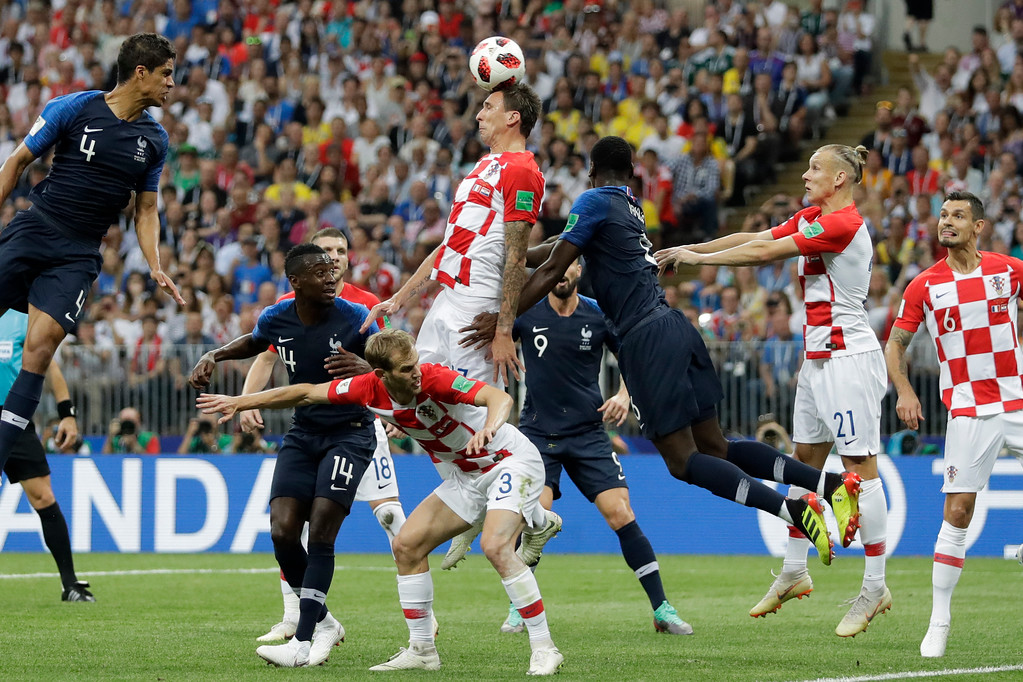 . Croatia\'s Mario Mandzukic, center, scores an own goal during the final match between France and Croatia at the 2018 soccer World Cup in the Luzhniki Stadium in Moscow, Russia, Sunday, July 15, 2018. (AP Photo/Matthias Schrader)