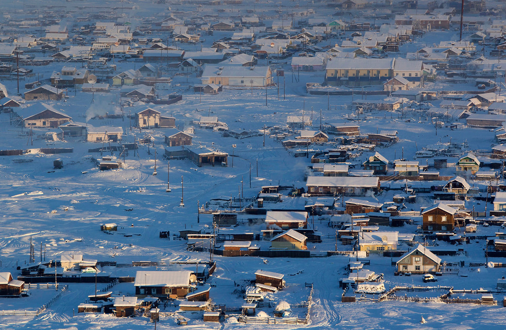 . A general view of the village of Tomtor in the Oymyakon valley, in the Republic of Sakha, northeast Russia, January 28, 2013. The coldest temperatures in the northern hemisphere have been recorded in Sakha, the location of the Oymyakon valley, where according to the United Kingdom Met Office a temperature of -67.8 degrees Celsius (-90 degrees Fahrenheit) was registered in 1933 - the coldest on record in the northern hemisphere since the beginning of the 20th century. Yet despite the harsh climate, people live in the valley, and the area is equipped with schools, a post office, a bank, and even an airport runway (albeit open only in the summer). Picture taken January 28, 2013.  REUTERS/Maxim Shemetov