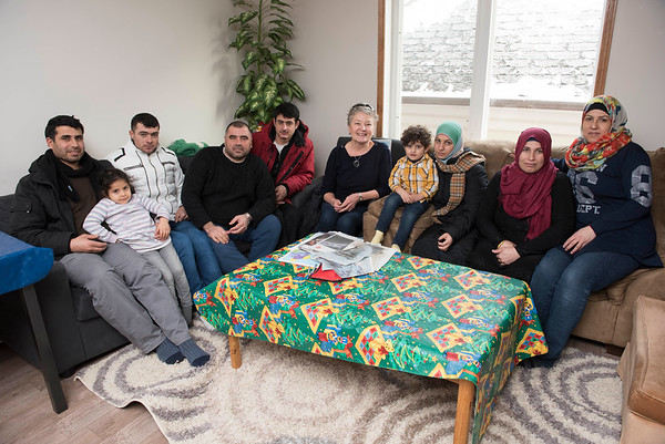 DAVID LIPNOWSKI / WINNIPEG FREE PRESS   left: Kamal Alhassan with daughter Rimus, 3, Ibrahim Alsaho, Fadel Ahmad, Anwar Alsaho, volunteer instructor Val Schellenberg, Rabah Alfreij with her son Mohammad Nour, Amouna Alhassan, Rania Ahmad, far right gather at the home of Fadel and Rania Ahmad for conversational English classes twice a week Tuesday January 17, 2017.