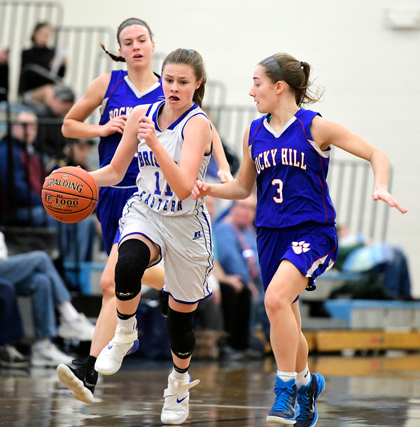 2/9/2019 Mike Orazzi | Staff Bristol Eastern's Ciara Collins (11) and Rocky Hill's Corrin Stabile (3)  during Saturday's girls basketball game in Bristol.