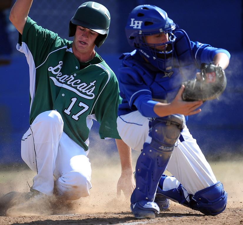 . Bonita\'s Cory Kurkierewicz (17) safe at home in the third inning of a prep baseball game against La Habra at La Habra High School on Tuesday, April 2, 2013 in La Habra, Calif. Bonita won 8-2.  (Keith Birmingham Pasadena Star-News)