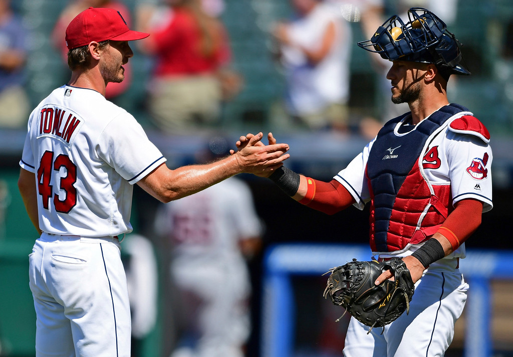 . Cleveland Indians relief pitcher Josh Tomlin, left, is congratulated by catcher Yan Gomes after defeating the Detroit Tigers in a baseball game, Sunday, June 24, 2018, in Cleveland. (AP Photo/David Dermer)