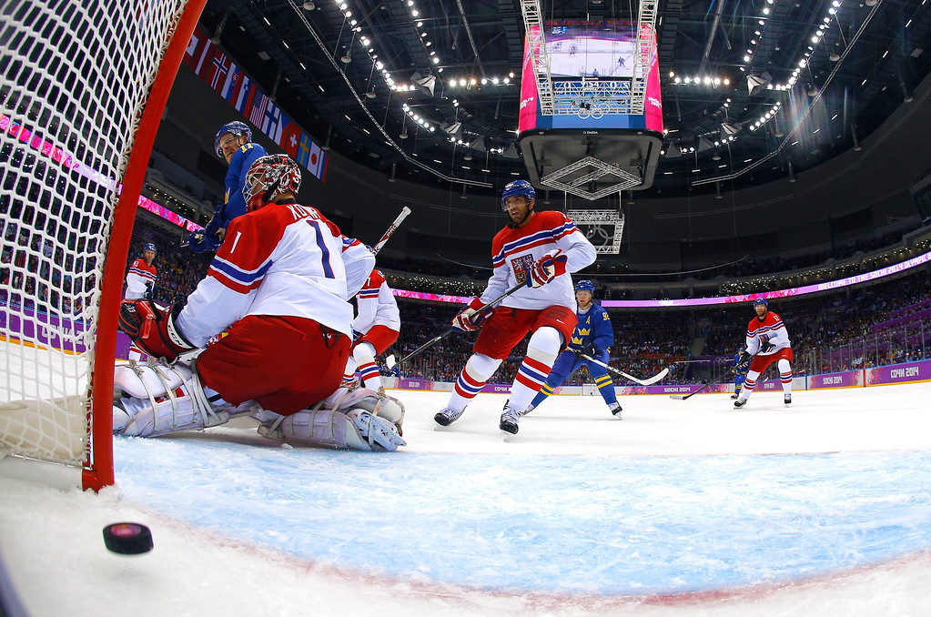 . SOCHI, RUSSIA - FEBRUARY 12:  Daniel Alfredsson #11 and Gabriel Landeskog #92 of Sweden celebrate teammate Erik Karlsson #65 goal in the first period against Jakub Kovar #1 of Czech Republic during the Men\'s Ice Hockey Preliminary Round Group C game on day five of the Sochi 2014 Winter Olympics at Bolshoy Ice Dome on February 12, 2014 in Sochi, Russia.  (Photo by Mark Blinch - Pool/Getty Images)