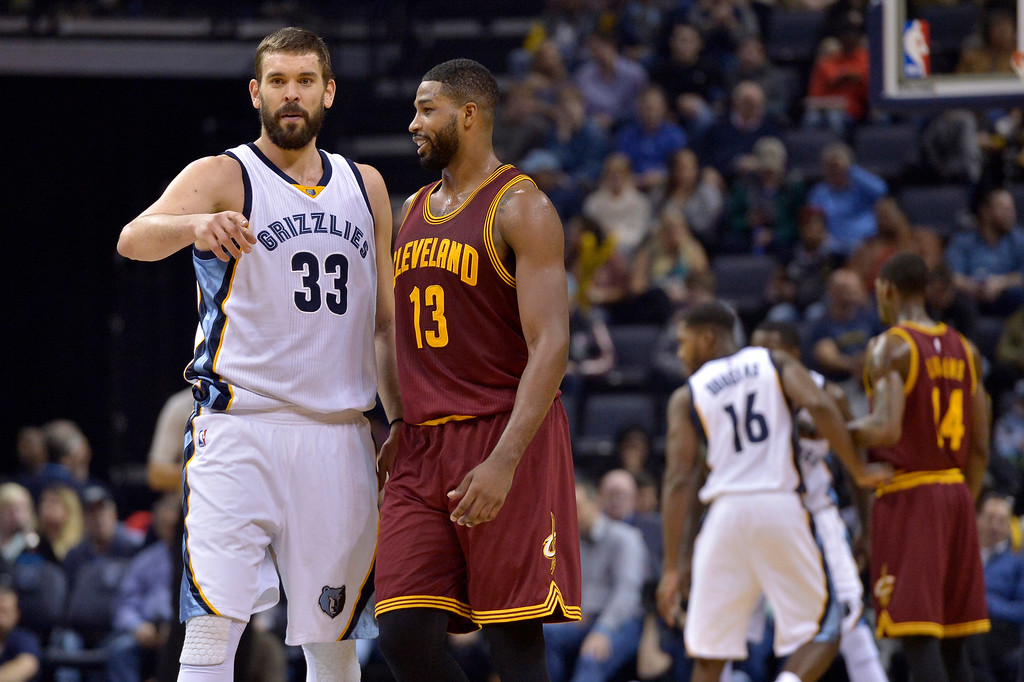 . Memphis Grizzlies center Marc Gasol (33) and Cleveland Cavaliers center Tristan Thompson (13) talk on the court between plays in the first half of an NBA basketball game Wednesday, Dec. 14, 2016, in Memphis, Tenn. (AP Photo/Brandon Dill)