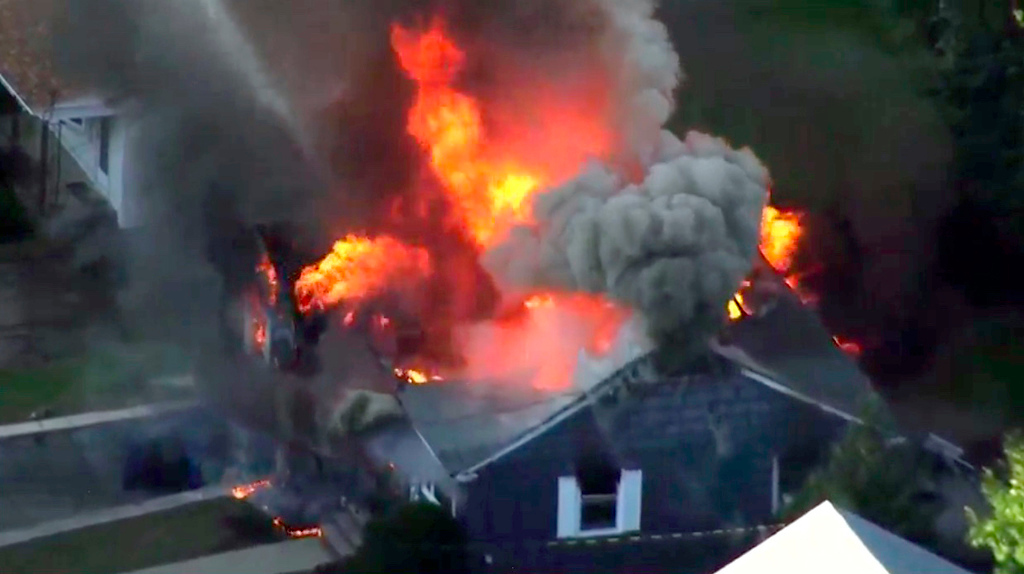 . In this image take from video provided by WCVB in Boston, flames consume a home in Lawrence, Mass, a suburb of Boston, Thursday, Sept. 13, 2018. Emergency crews are responding to what they believe is a series of gas explosions that have damaged homes across three communities north of Boston. (WCVB via AP)