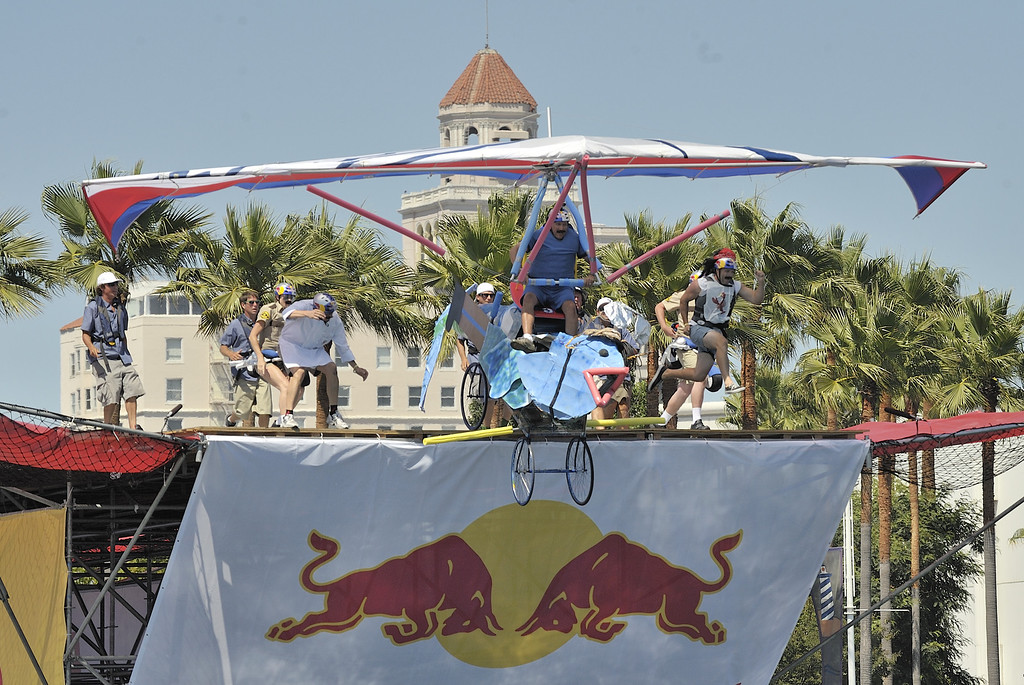 """. LONG BEACH, CALIF. USA -- John Sangmeister pilots his team\'s Flugtag entry \""""Fish \'n CHiPs\"""" in Rainbow Harbor in Long Beach, Calif. on August 21, 2010. Thirty five teams competed in the Red Bull event where teams build homemade, human-powered flying machines and pilot them off a 30-foot high deck in hopes of achieving flight.  Flugtag means \""""flying day\"""" in German. They are on distance, creativity and showmanship..Photo by Jeff Gritchen / Long Beach Press-Telegram.."""