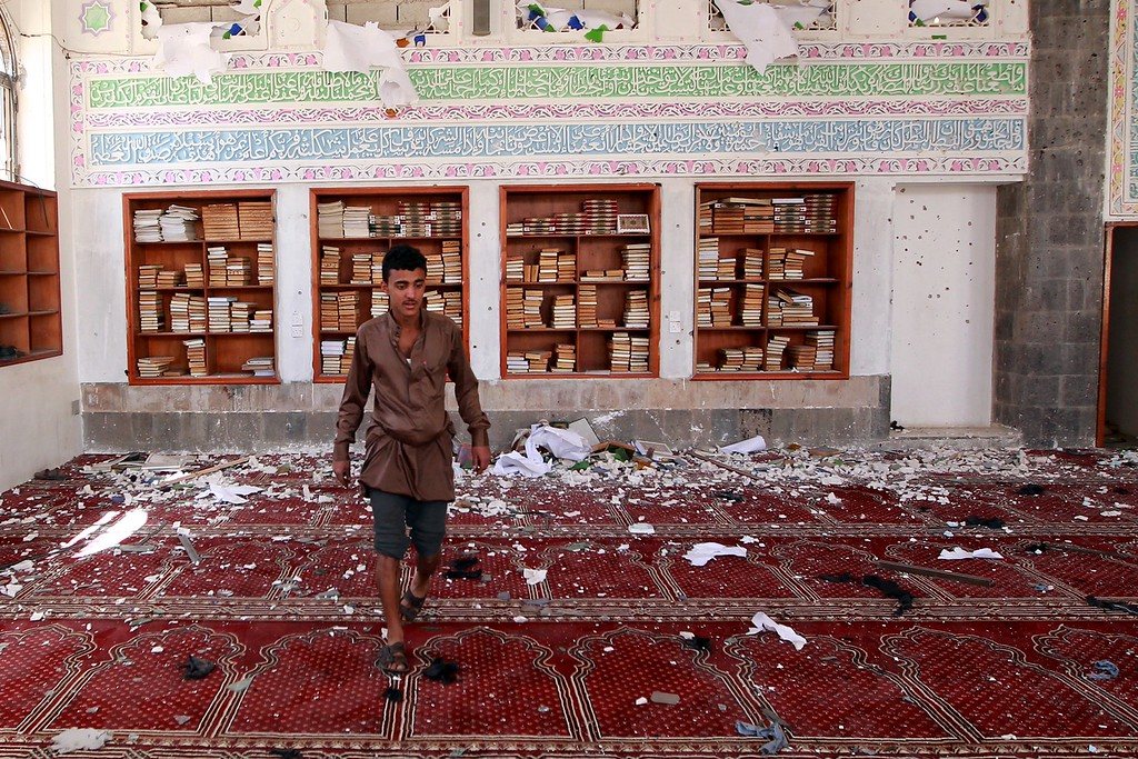 . A Yemeni man inspects the damage following a bomb explosion at the Badr mosque in southern Sanaa on March 20, 2015. Triple suicide bombings killed at least 55 people at mosques in the Yemeni capital attended by Shiite Huthi militiamen who have seized control of the city. AFP PHOTO / MOHAMMED HUWAIS/AFP/Getty Images