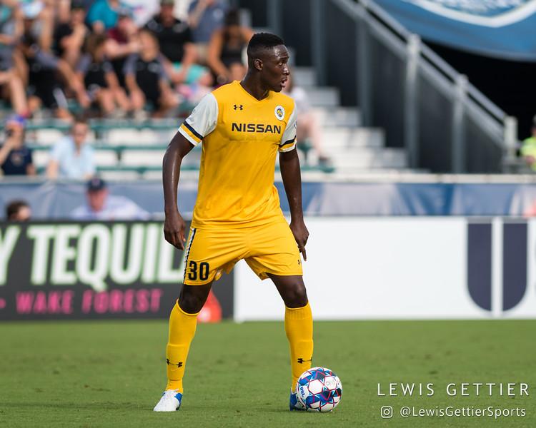 Nashville SC midfielder Bolu Akinyode (30)