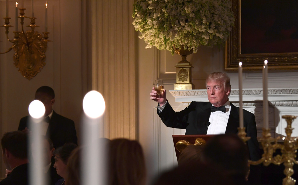 . President Donald Trump offers up a toast to French President Emmanuel Macron during the State Dinner at the White House in Washington, Tuesday, April 24, 2018. (AP Photo/Susan Walsh)