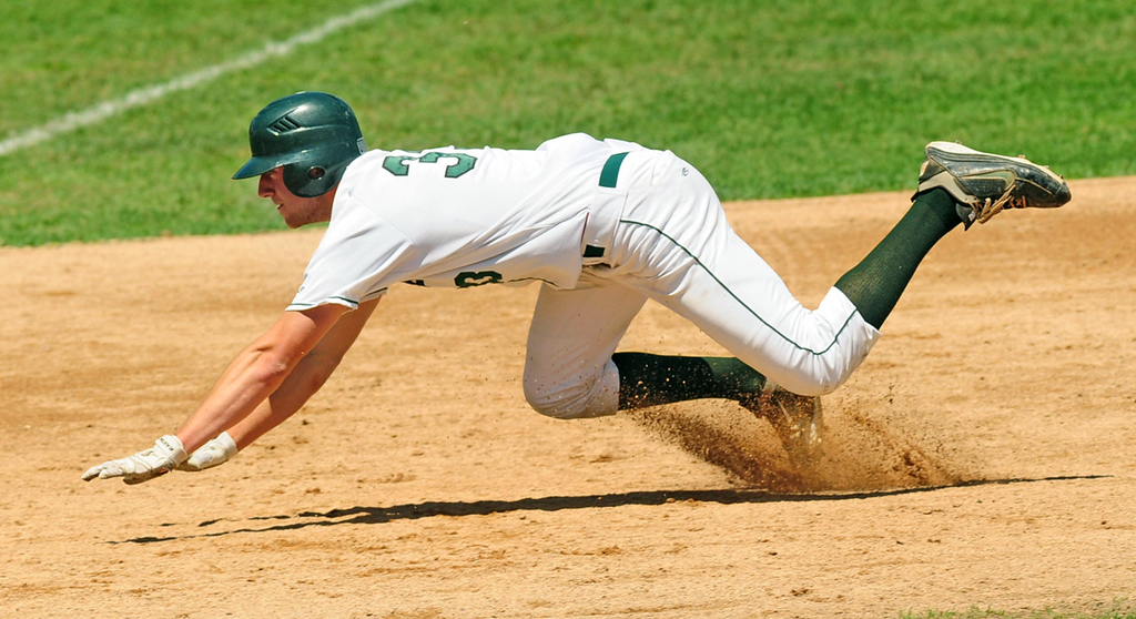 . Mounds View\'s Max Knutson slides into third base in the fourth inning, after a fielding error by Forest Lake\'s Kyle Parker allowed him to reach third on his single.  (Pioneer Press: Scott Takushi)