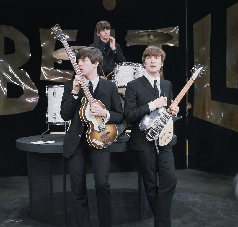 ". British rock band the Beatles are shown during rehearsals on the set of the ""Ed Sullivan Show\"" in New York, Feb. 9, 1964.  On drums is Ringo Starr, bassist is Paul McCartney, left, and guitarist is John Lennon.  (AP Photo)"