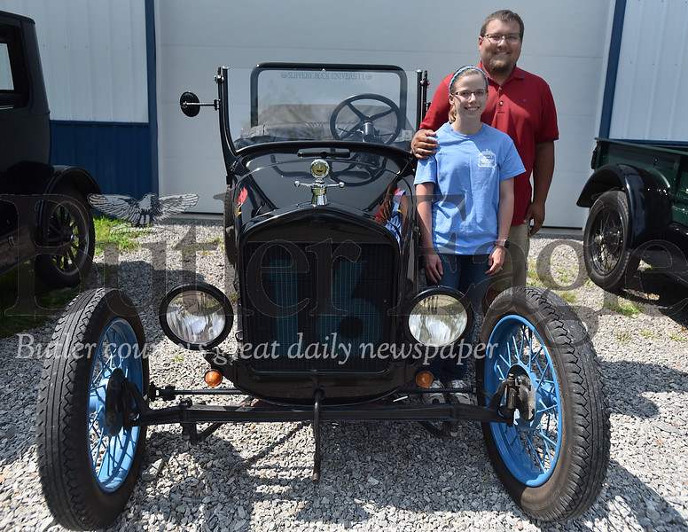 97300 Simon Neubert shows his and his families Model T cars at his house in Jefferson Twp