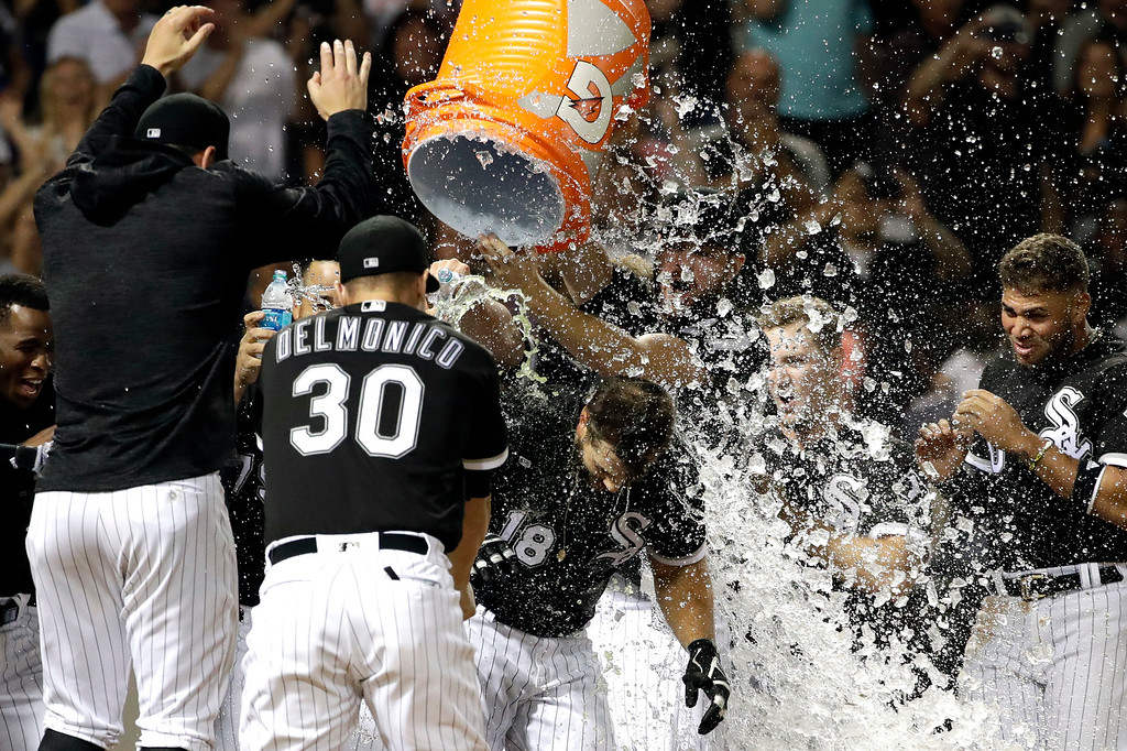 . Chicago White Sox\'s Daniel Palka (18) celebrates with teammates after hitting the game-winning solo home run against the Cleveland Indians during the ninth inning of a baseball game Friday, Aug. 10, 2018, in Chicago. The White Sox won 1-0. (AP Photo/Nam Y. Huh)