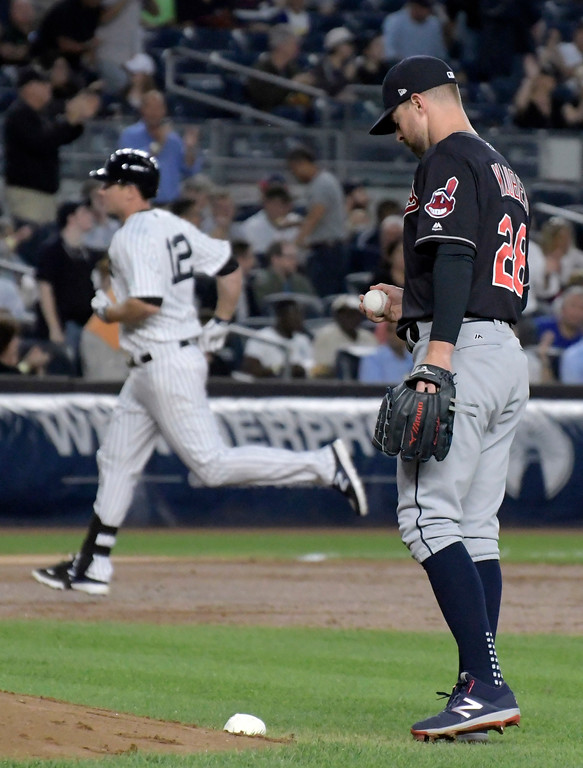 . Cleveland Indians pitcher Corey Kluber, right, reacts as New York Yankees\' Chase Headley rounds the bases with a home run during the third inning of a baseball game, Monday, Aug. 28, 2017, at Yankee Stadium in New York. (AP Photo/Bill Kostroun)