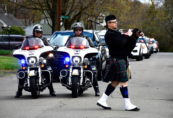 4/16/2020 Mike Orazzi | Staff Bagpipe player Tim Branch leads various law enforcement and fire departments as they show respect for the Medena family after their father recently passed away. The man's son, Jude Medena is a member of the UConn Police Department.