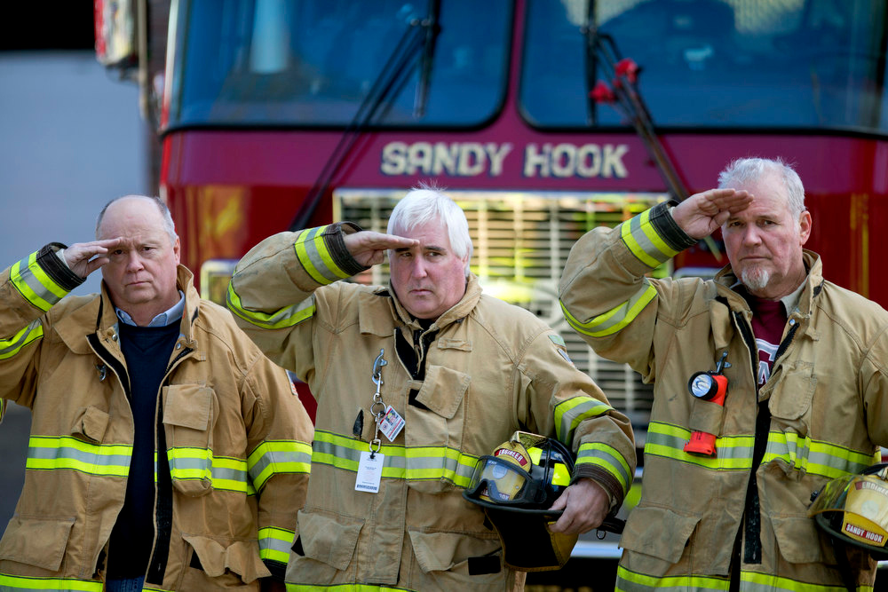 Description of . Firefighters salute as a hearse passes for the funeral procession to the burial of 7-year-old Sandy Hook Elementary School shooting victim Daniel Gerard Barden, Wednesday, Dec. 19, 2012, in Newtown, Conn. Barden was killed when Adam Lanza walked into Sandy Hook Elementary School in Newtown, Conn., Dec. 14, and opened fire, killing 26 people, including 20 children, before killing himself.(AP Photo/David Goldman)