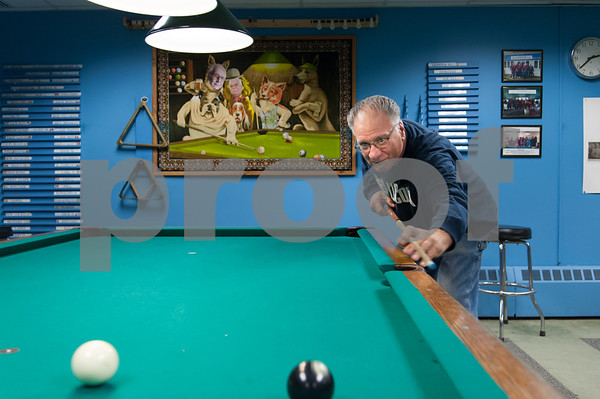 12/05/17 Wesley Bunnell | Staff Richard Berardy eyes his shot during a game of 8 ball at the Bristol Senior Center on Tuesday afternoon.
