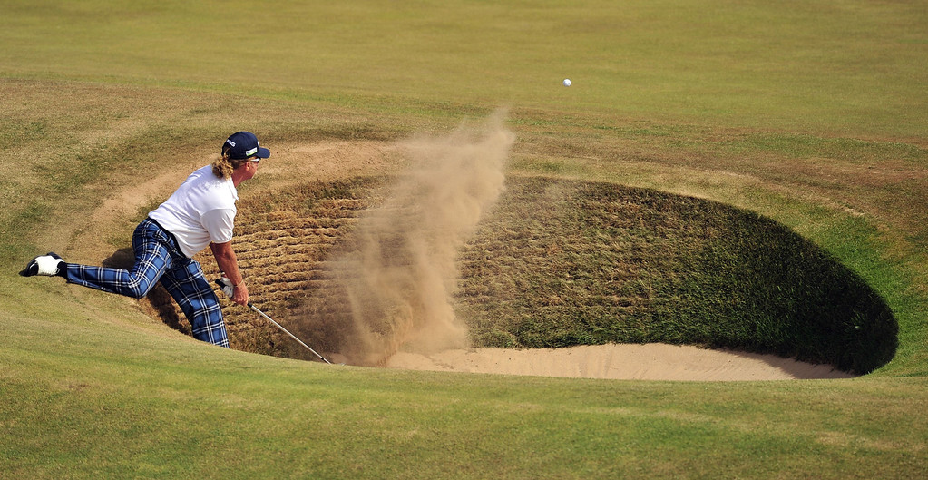 . Spain\'s Miguel Angel Jimenez plays a shot out of a bunker on the fourth during the third round of the 2013 British Open Golf Championship at Muirfield golf course at Gullane in Scotland on July 20, 2013.  GLYN KIRK/AFP/Getty Images