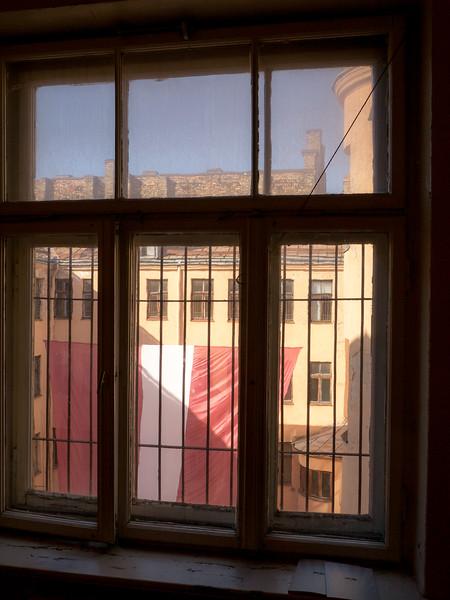 Latvian flag flys proud inside the former KGB Hdqtrs
