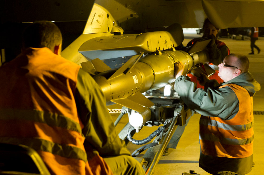 Description of . A Rafale fighter is armed at the Saint Dizier airbase in central France before being deployed in Mali,  in this picture provided by the French Military Communications Audiovisual office (ECPAD) and taken on January 13, 2013. Al Qaeda-linked Islamist rebels in Mali launched a counter-offensive on Monday after three days of strikes by French fighter jets on their strongholds in the desert north, vowing to drag France into a long and brutal ground war. Photo taken January 13, 2013. Mandatory Credit.  REUTERS/SGC. Laure-Anne Maucorps/ECPAD/Handout